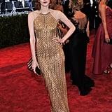 Karen Elson shimmered in a gold beaded and fringed Julien Macdonald halter gown.