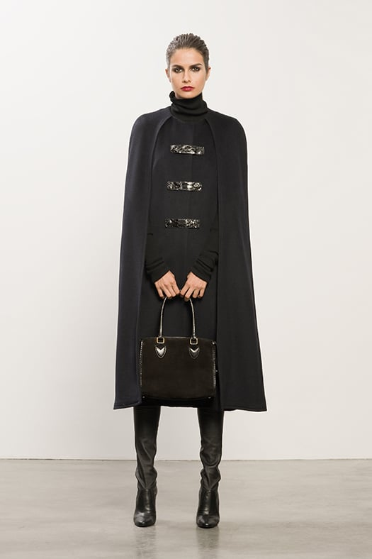 Wool Long Navy Cape With Snakeskin Detail, Cashmere Black Turtleneck Sweater, Sweet Revenge Black Leather Legging Boot, Seductive Black Suede Satchel. Photo courtesy of Tamara Mellon
