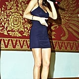 Victoria wearing a simple black spaghetti-strap dress for the Spice Girls' first-ever performance in 1997.