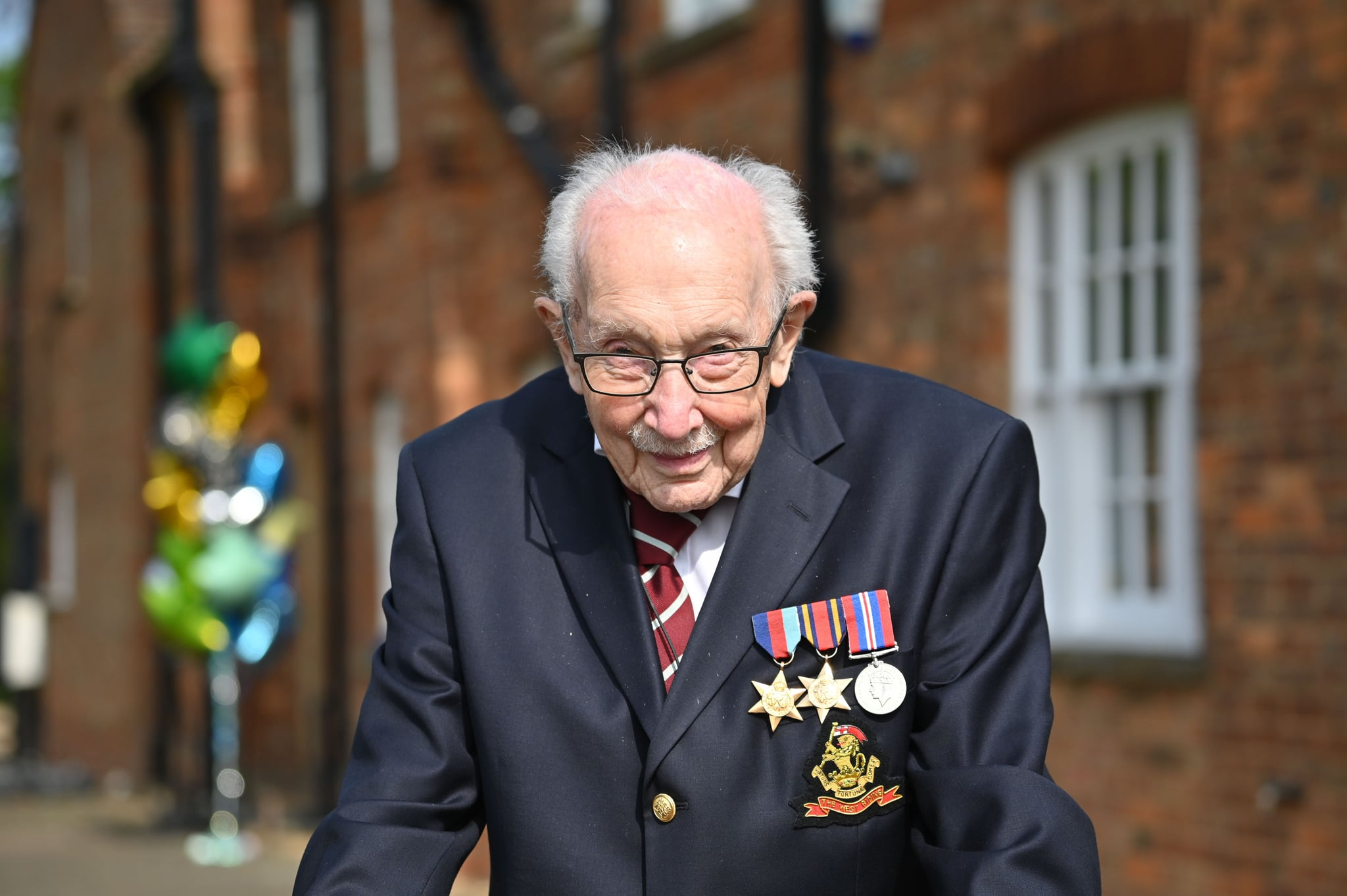British World War II veteran Captain Tom Moore, 99, poses doing a lap of his garden in the village of Marston Moretaine, 50 miles north of London, on April 16, 2020. - A 99-year-old British World War II veteran Captain Tom Moore on April 16 completed 100 laps of his garden in a fundraising challenge for healthcare staff that has