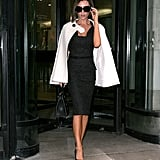 Victoria in a tweed dress and cape while out in New York in 2008.