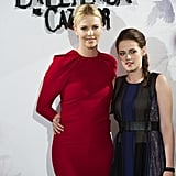 Charlize Theron wore a bright red dress with Kristen Stewart went with a darker frock for the Snow White and the Huntsman photocall in Madrid.