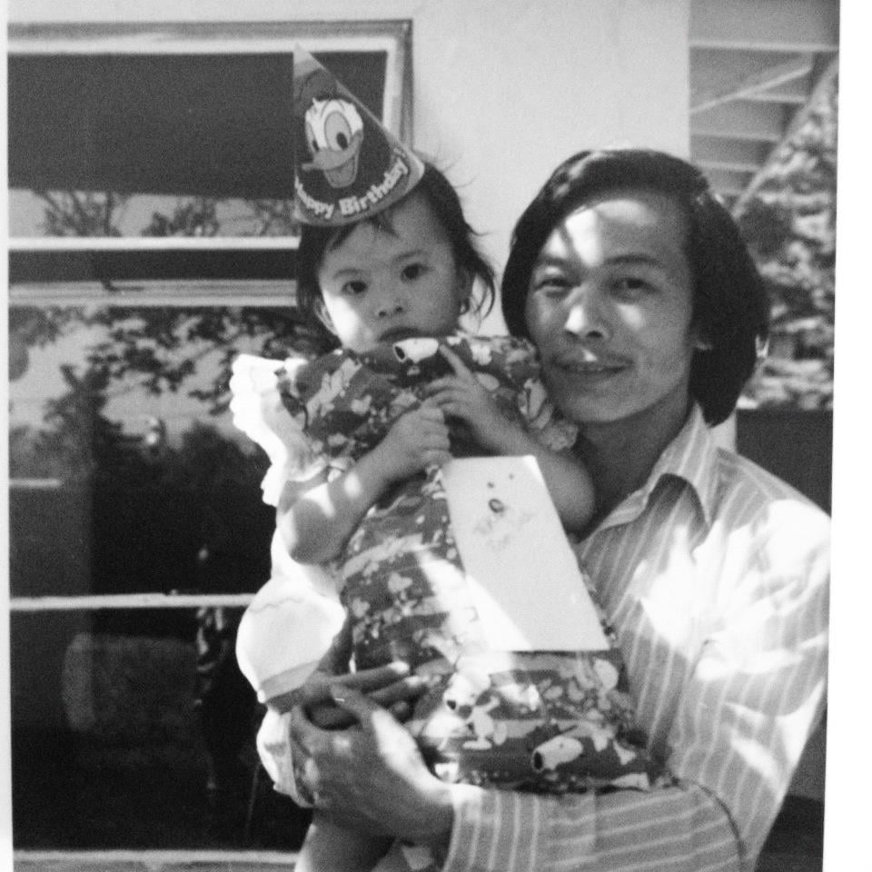 """This picture of me and my pops was taken at my third birthday party. You can't tell because the birthday gift is covering most of my outfit, but I was wearing a ruffled minidress, socks, and sandals. However, my fashion sense pales in comparison to my father's — how cool does my dad look with his long hair and side part?"" — Chi Diem Chau, FabSugar associate editor"