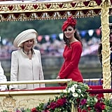 Queen Elizabeth II; Camilla, duchess of Cornwall; Catherine, duchess of Cambridge; and Prince Philip, duke of Edinburgh, looked out from the barge.