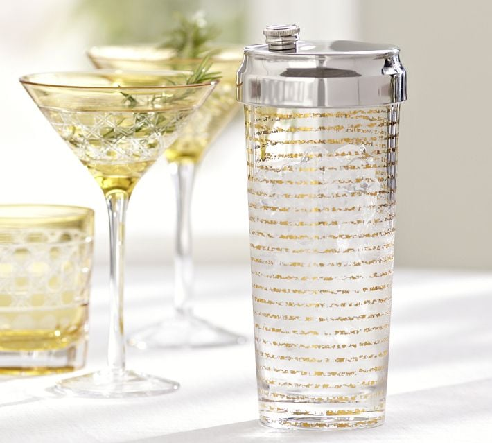 The Pottery Barn Gold Stripe Cocktail Shaker ($36) would bring glitz and glamour to any bar setup.