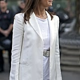 Carine Roitfeld looks chic in a white blazer thrown over a tee.