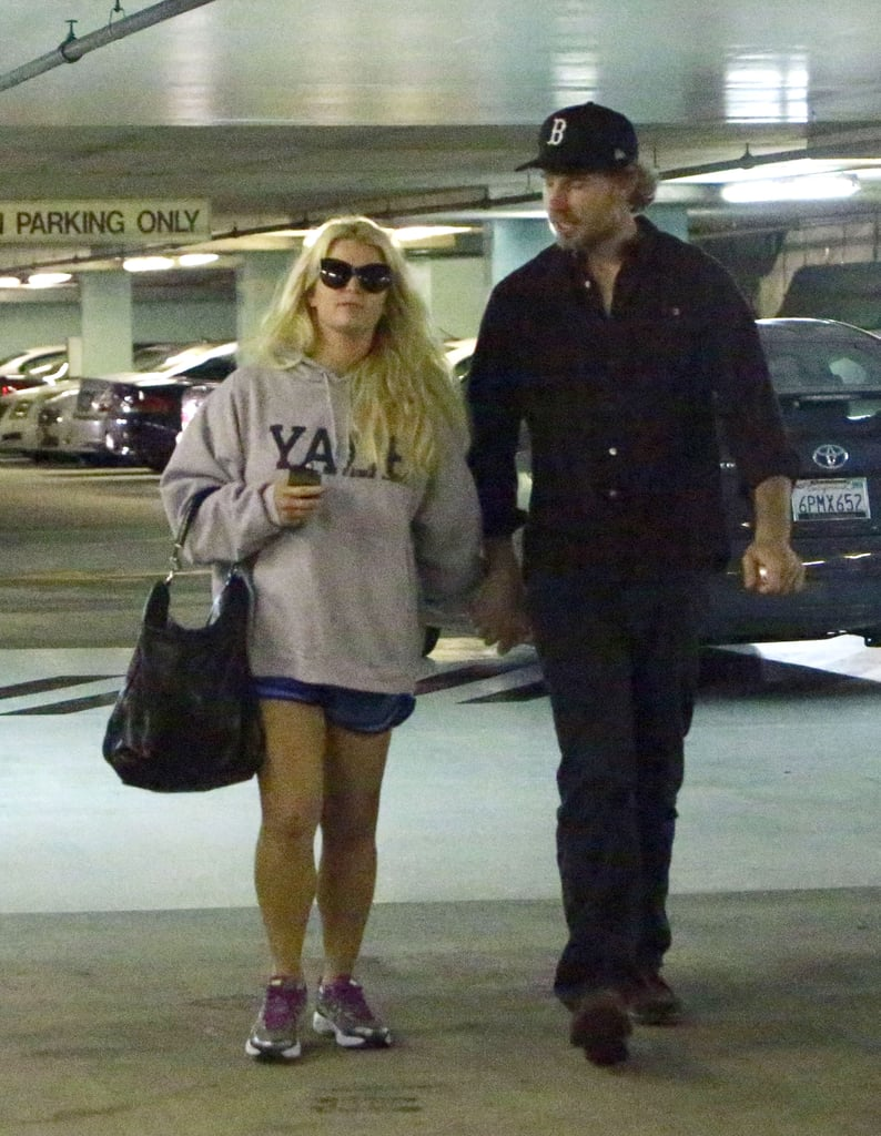 "Jessica Simpson and Eric Johnson were together to run errands in LA yesterday. She was decked out in what looked like her workout gear, as well as one of her favorite items, Eric's Yale sweatshirt. They were able to spend time together during a break from Jess's hectic work schedule. She's been balancing work on the new season of Fashion Star with her responsibilities running the Jessica Simpson Collection. Earlier this week, Jess logged time on a shoot for her megabrand. She tweeted a photo from the beach location Thursday, ""Just finished shooting Spring '13 ad campaign for the Jessica Simpson Collection. Doesn't get better than this!"""