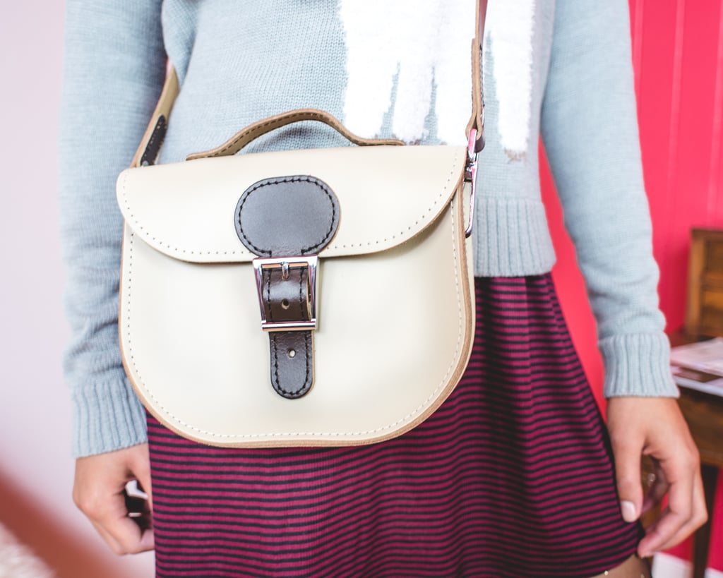 A mini satchel will up her bag game and can easily take her from work to drinks.