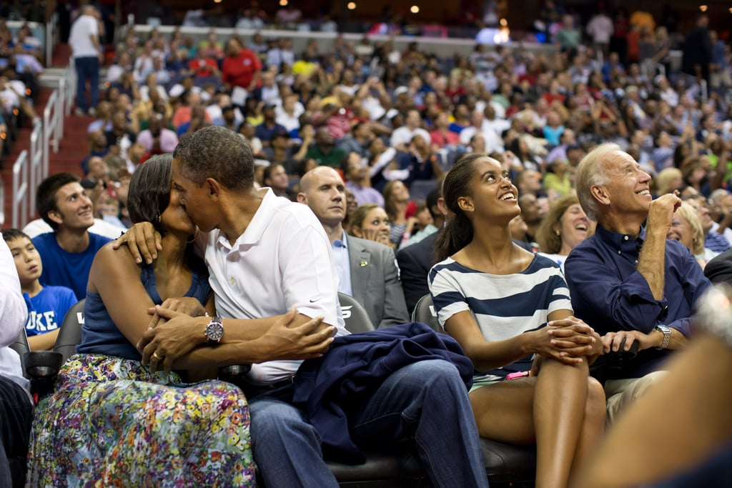 Barack and Michelle went for it after getting caught on the Kiss Cam at a basketball game in Washington DC.