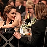 Angelina glanced at Brad.