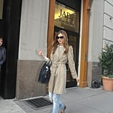 Miranda put a chic spin on classic trench styling by pairing her khaki coat with distressed jeans, leopard-print loafers, and a Céline luggage tote.