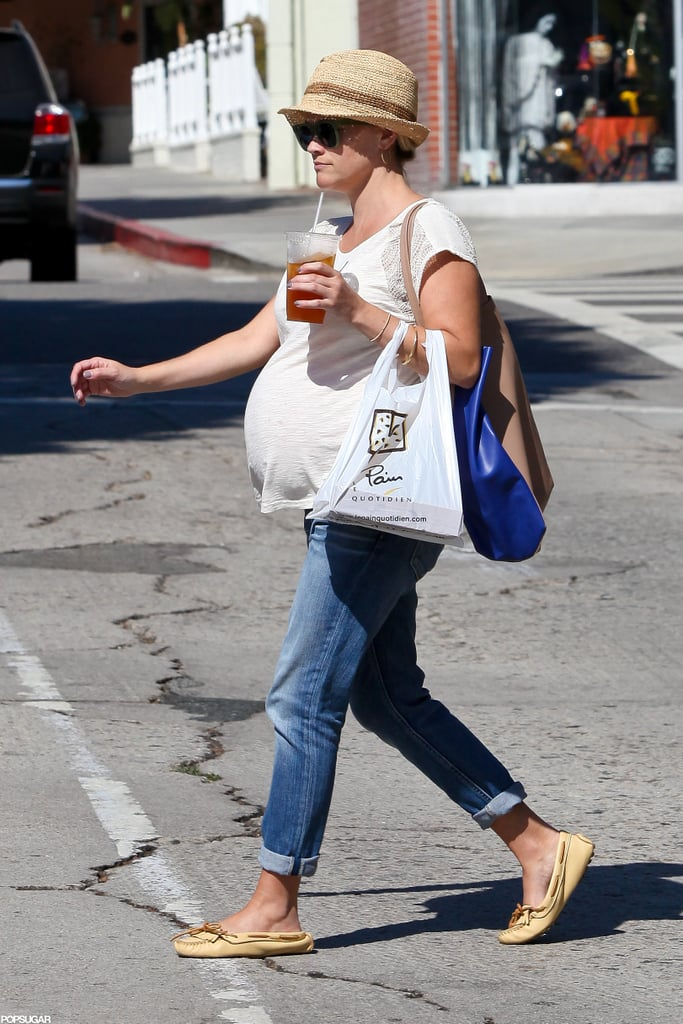 Reese Witherspoon didn't let her growing bump get in the way of a busy afternoon of errands in LA yesterday. She stopped by Barneys and later picked up takeout from Le Pain Quotidien. Reese is prepping for the birth of her third child, who will join her older children, Ava and Deacon. It will be Reese's first baby with husband Jim Toth, and the couple has been fitting in sweet outings in their downtime recently. In the midst of her pregnancy excitement, Reese has also been focused on work with her production company picking up the rights to popular books Wild and Gone Girl.