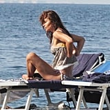 Helena Christensen in a shirt and bikini.