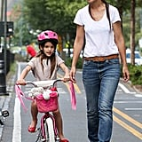 Suri teeters slightly as she and her mum, Katie Holmes, make their way down the West Side Highway in NY.