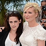 Kristen Stewart and Kirsten Dunst embraced for at the On the Road photocall at the Cannes Film Festival.