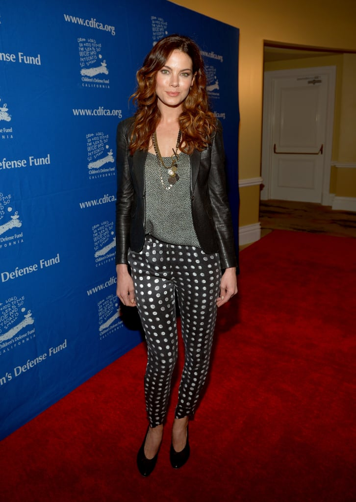 Michelle Monaghan took the alternative to the party dress in a pair of slim polka-dot pants, a leather blazer, and black booties.