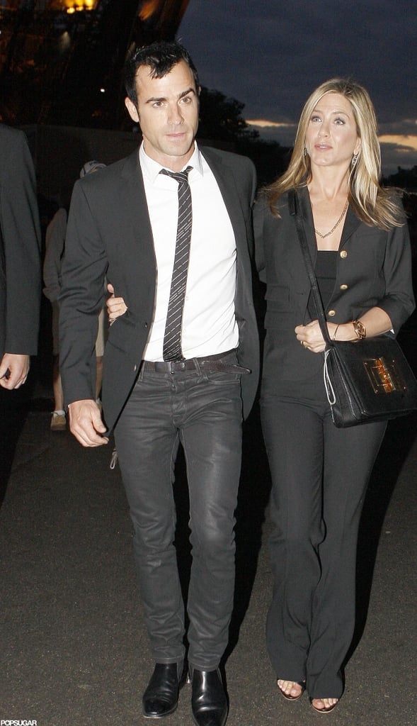 """Jennifer Aniston and Justin Theroux held hands as they walked up to the Eiffel Tower in Paris this evening. Jen showed some tummy as she left their hotel, armed with a Tom Ford bag. Despite the rainy weather, the couple stepped out for a romantic evening at the attraction's famed Le Jules Verne restaurant. Jennifer and Justin are in France on vacation and have already been spotted touring the city and shopping this week. They also shared a meal at one of Jen's favorite dinner spots, Le Stresa. Their relationship is clearly going strong and Justin shared his happiness recently, saying, """"I'm the luckiest guy in the world."""""""