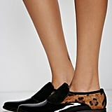 """""""I'll choose flats over heels any day and these Free People Slip On Loafers ($98) are right on trend. The leather and suede combo give the shoe just the right amount of flair."""" — Marina Liao, editorial assistant, Trending and Social"""