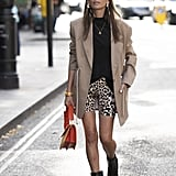 We're partial to boots, a blazer, and biker shorts for a cool alternative to your weekend brunch look.