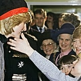 A young boy sweetly touched Diana's face as she visited Liverpool, England, in December 1982.