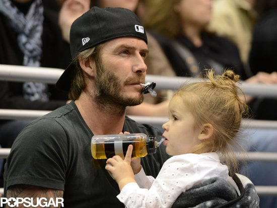 David Beckham put on his game face with Harper Beckham at the LA Kings hockey game.