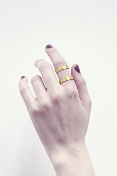 A pretty, architectural ring like Young Frankk's Double Band Brass Ring ($62) is something she can wear every day.