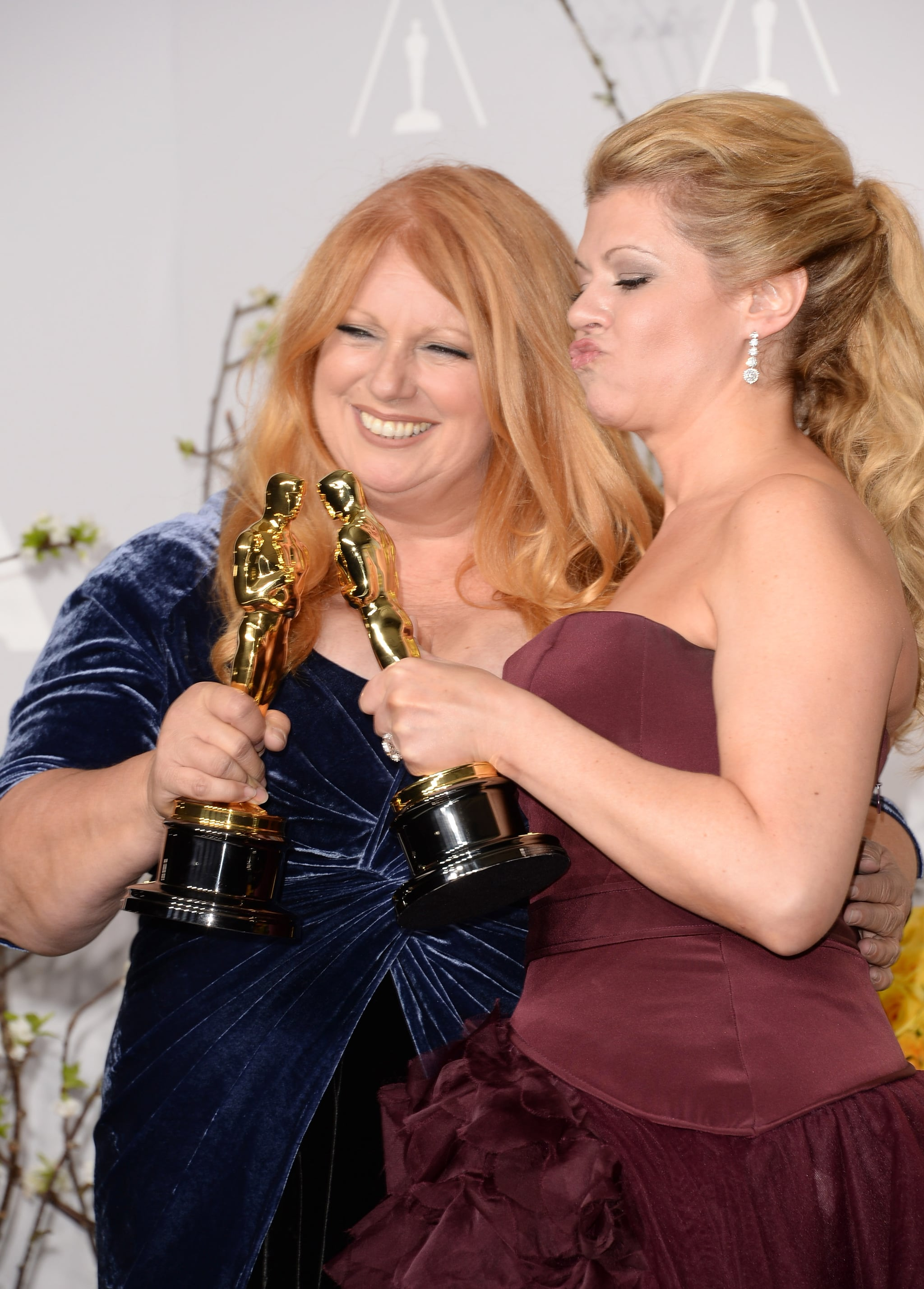 Adruitha Lee and Robin Mathews clinked their Oscars after their best makeup and hairstyling win for Dallas Buyers Club.