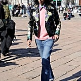 With a polished sweater, jacket, and flats