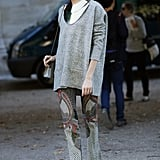 A major collar necklace offset a chunky knit and upstaged a pair of printed pants.