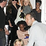 Angelina held onto Knox walking down the steps to their awaiting ride.