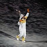 A torchbearer entered the stadium.