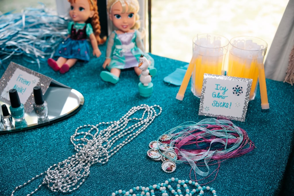 Since young kids love to play dress-up, Anna made sure to provide Frozen play jewelry ($12 for six necklaces) as party favors for the young guests.