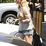 Kirsten Dunst carried her purse in one hand and bag in the other.