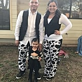 Why not make your little Selena's costume a family affair? Your little one can wear a black skirt and crop top with a cow-print jacket, while you and your partner can go all out with matching pants as Los Dinos.