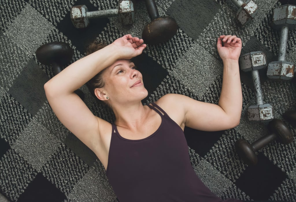 No Need to Stand! This Arms and Abs Dumbbell Workout Is All on the Floor