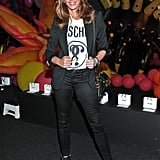 She Wore a Moschino Tee With Black Jeans and Velvet Boots