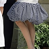 She accessorised her outfit with black-and-white pumps.