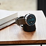 The charging dock itself is wired and plugged into the wall but requires no cords or ports to charge the watch.