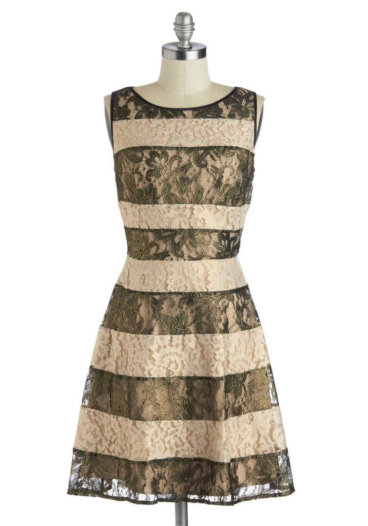 Less harsh than stark black and white, the bronze and champagne colors of this ModCloth find ($118, originally $168) make an elegant option for your next evening event.