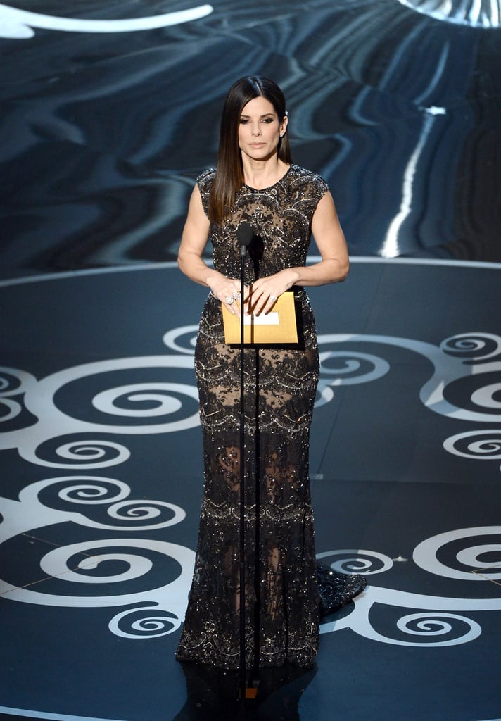 Sandra Bullock arrived on the red carpet at the Oscars today wearing Elie Saab. The actress nabbed her first Oscar nomination in 2010 for The Blind Side, and went on to take home the trophy that year. Sandra is not among the nominees tonight, but she was one of the celebrities presenting an Oscar. She took the stage to hand out one of the evening's many awards, presenting Argo with an honor in editing.  As a regular attendee for roughly a decade now, Sandra has certainly shown off her style throughout the years. Let us know what you think of her gown tonight, as well as others, with our Oscars fashion and beauty polls.