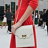 This classic chain-strap bag played right into her ladylike look. Source: IMAXtree