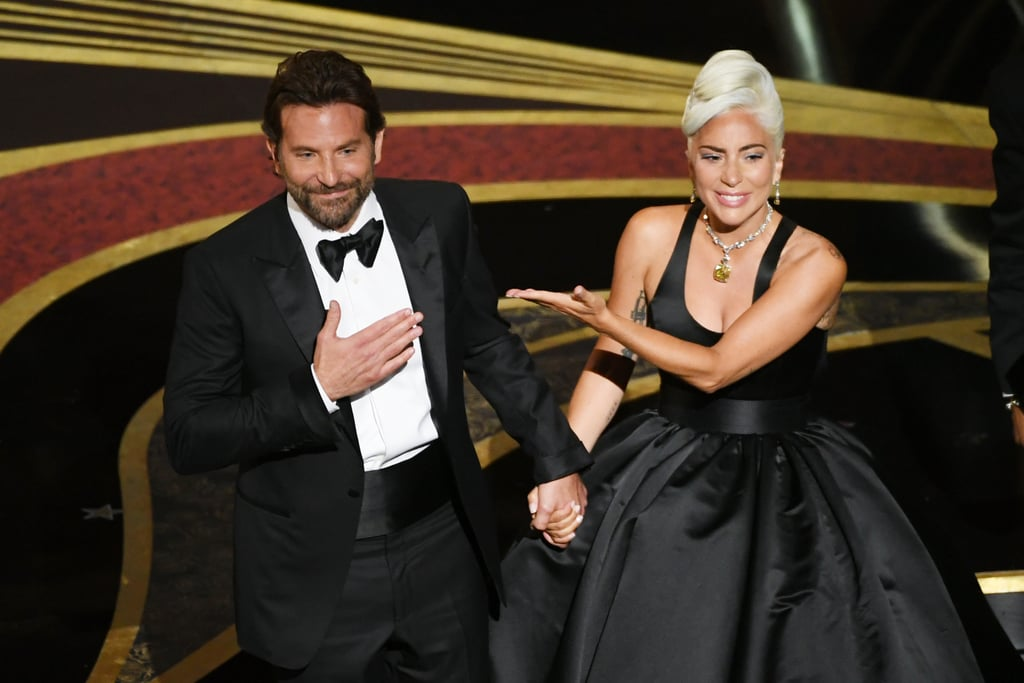 """Even the audience at the Oscars couldn't contain their cool after Lady Gaga and Bradley Cooper's dazzling performance. After belting out """"Shallow"""" on stage together — and changing our lives forever with their crazy chemistry — the A Star Is Born costars received yet another standing ovation following their performance. Yes, another standing ovation just for taking their seats. We stan an iconic duo!       Related:                                                                                                           Sorry, What Were You Saying? I Blacked Out After Seeing Lady Gaga and Bradley Cooper Together"""