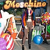 Katy Perry wearing high-waisted jeans and a furry rainbow coat at the Moschino x Candy Crush Desert party.