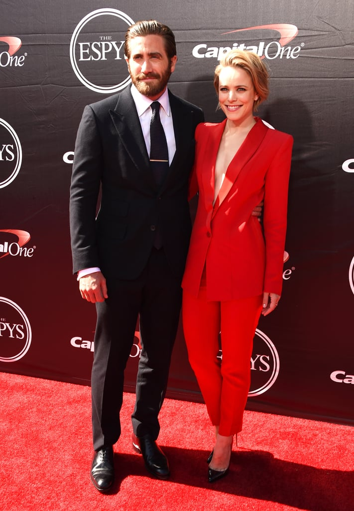 Jake Gyllenhaal and Rachel McAdams were their usual devastatingly good-looking selves while hitting the red carpet at the ESPYs on Wednesday. They braved the LA sun in sharp suits — a classic black for Jake and sexy low-cut red for Rachel — and stayed close while posing for photos together. Rachel and Jake have begun promoting their boxing drama Southpaw ahead of its release on July 24 and are each doing their part to talk up the film, in which they play a couple. A behind-the-scenes video was released this week showing Jake prepping for his role in the ring, and it was undeniably sexy; we highly suggest watching it and looking through the best moments if you haven't already. Rachel, who is rumoured to be dating her True Detective costar Taylor Kitsch, couldn't help but get the giggles when asked about their possible relationship during a recent interview. Keep reading to see Jake and Rachel's night at the ESPYs.