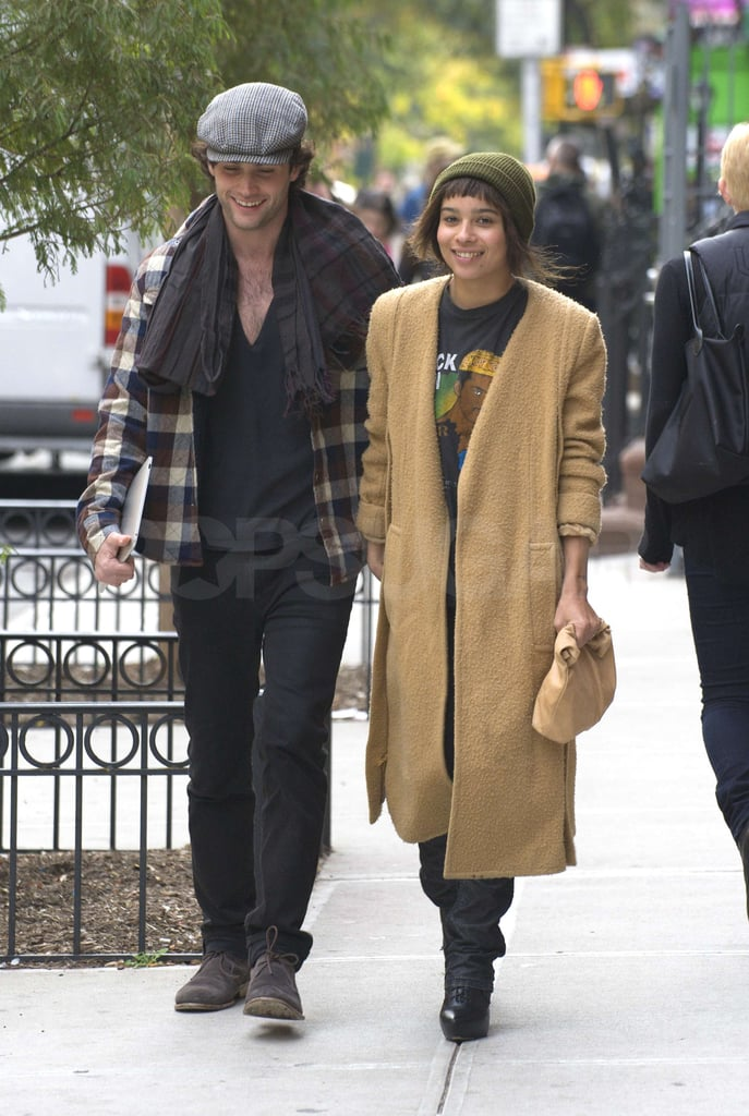 Penn Badgley and Zoe Kravitz took their romance public once again today as they went on a walk in the Big Apple. The couple held hands as they strolled the streets, and Penn didn't go unnoticed by a group of Gossip Girl fans, who flagged him down as they walked by. Zoe patiently waited on the sidewalk while he stopped to take some photos with them. Zoe and Penn haven't spoken out publicly about their relationship, but Zoe did attend the recent premiere of Penn's new film Margin Call, and the pair also were spotted kissing in Manhattan earlier this month. Before she and Penn were an item, Zoe was frequently spotted out with her X-Men: First Class costar Michael Fassbender. Previous to linking up with Zoe, Penn took some time to live the single life, having split from his girlfriend of three years — Blake Lively — last October.