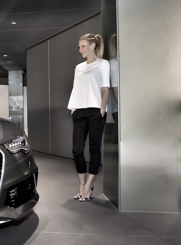 Gwyneth Paltrow played with proportions in her black and white ensemble at the Audi RS 6 charity event in London. She paired a white swingy top with black cropped trousers, then added variety with a pair of black and white printed pumps.