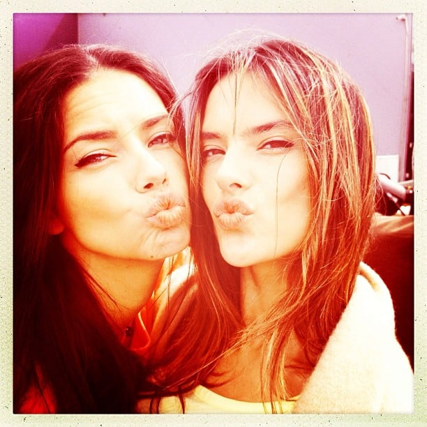 Adriana Lima and Alessandra Ambrosio blew kisses to the camera during a Victoria's Secret photo shoot. Source: Instagram user alecambrosio