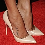 "The Arabic writing by her toes is rumored to say ""I want to ask her."""