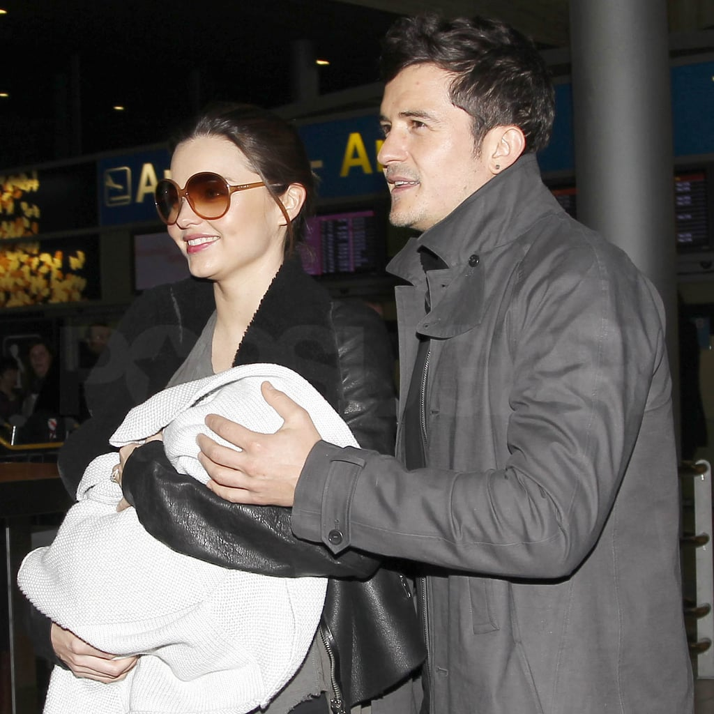 Miranda Kerr and Orlando Bloom touched down in Paris yesterday with their son Flynn. The couple were firm fixtures at Paris Fashion Week last season when Miranda was pregnant, and this year they've brought their new addition along to join in the fashion fun. Miranda just walked for Balenciaga, after a meeting at their office yesterday. The model also tweeted that they've made the trip a family affair with Orlando's parents. Orlando and Miranda have been enjoying the LA sun with Flynn, going for lunch and taking strolls in the park.