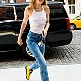 The tank and jeans may be on the simpler side, but Gigi's coordinating sunny shades and boots certainly are not.